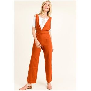 Woman's rust red twill A-line wide leg jumpsuit